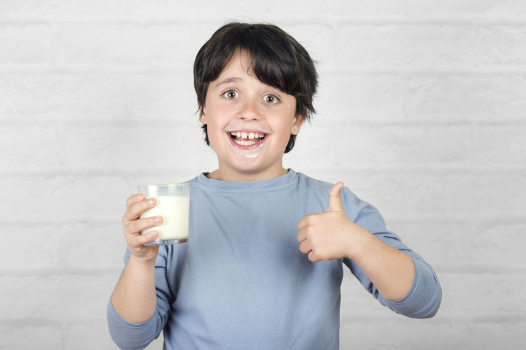 Smiling Portrait Drink Food And Drink Happiness Holding Refreshment Drinking Child Childhood Dairy Product Glass Emotion Milk Drinking Glass Glass Of Milk Diet Tasty Fresh Kid Calcium Growth Happy Happiness Healthy Healthy Eating Ingredient Breakfast Nutrition Delicious Lifestyle Mustache Funny Smile White Taste Health Thirst Vitamin Vitality Wellbeing Cute Enjoy Organic Expression Appetizing  People Concept