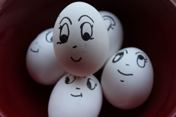 Close-up of face drawn on easter eggs in bowl