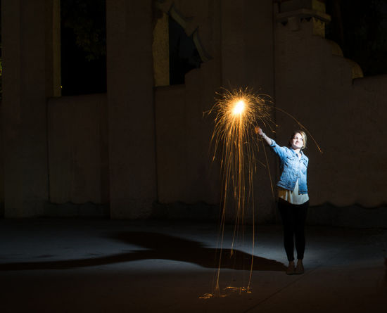Shadows and light Dark Fireworks Wall Casual Clothing Darkness And Light Full Length Illuminated Jacket Lifestyles Light And Shadow Night One Person Outdoors Outside Photography People Real People Sparkler Standing Wire Wool Young Adult