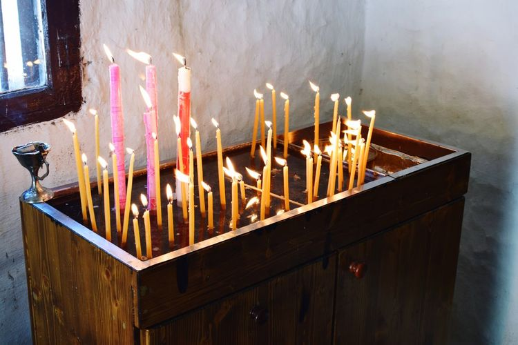 Lit Candles On Altar In Church