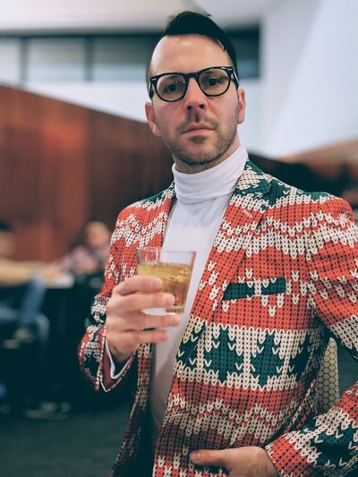 Portrait of fashionable man drinking whiskey