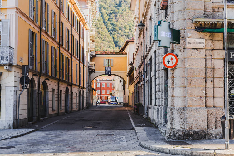 Random street in Italy. Architecture Building Exterior Built Structure Sign Building City Communication Road Sign Direction Road Street No People The Way Forward Day Residential District Information Outdoors Text Guidance Information Sign Alley Streetphotography Switzerland Landscape Vacations
