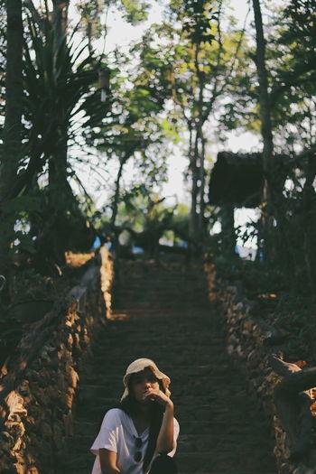 Woman sitting on steps in public park
