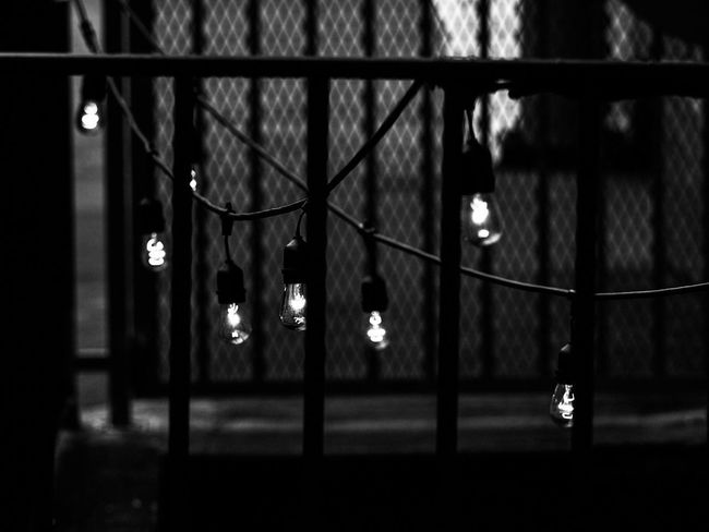 street light bw bnw Hayes Valley urban SF street style streetphotography_bw Street Life moody lightbulb San Francisco Gate Ironwork Street Light street photography depth of field EyeEmNewHere Bw Bnw Hayes Valley Urban SF Street Style Streetphotography_bw Street Life Moody Lightbulb San Francisco Gate Ironwork  Street Light Street Photography Black And White Hanging Focus On Foreground No People Illuminated Indoors  Night Close-up