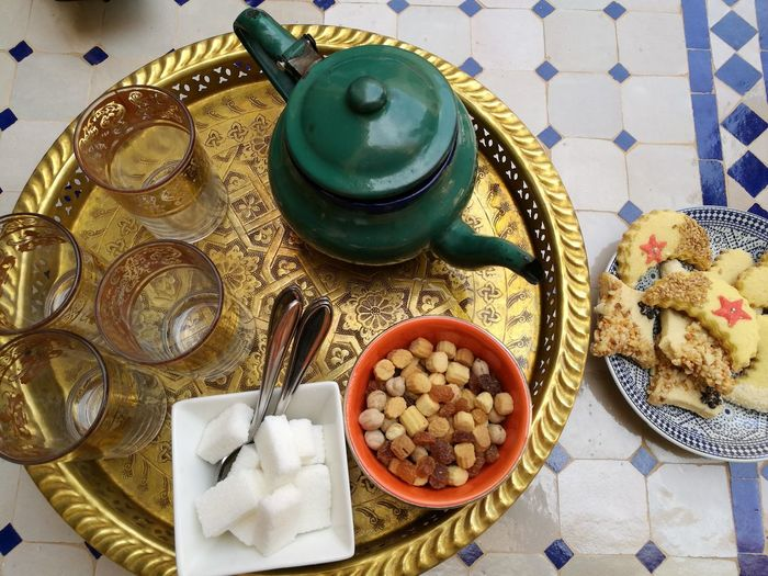 Morocco teatime Soonjourney MyWanderLust Morocco Africa Relaxing Drink Tea - Hot Drink Teapot Tablecloth Plate Table High Angle View Mint Tea Directly Above Herbal Tea Black Tea Tea Leaves Afternoon Tea Tea Crop Sugar Cube Tea Tea Cup Non-alcoholic Beverage Tea Kettle Served Hot Drink