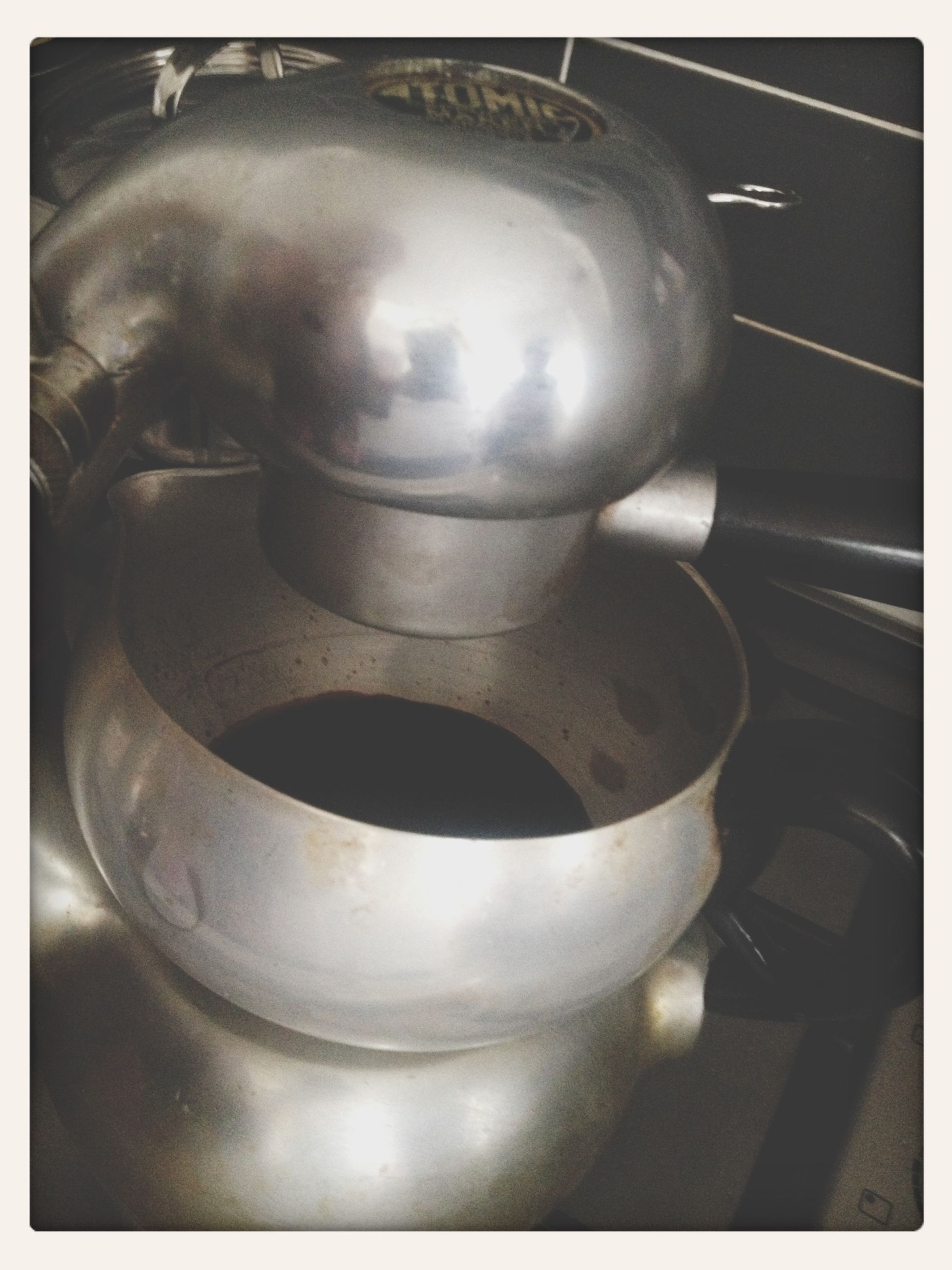 indoors, transfer print, still life, close-up, auto post production filter, food and drink, table, metal, high angle view, spoon, container, kitchen utensil, no people, drink, metallic, refreshment, domestic kitchen, glass - material, coffee cup, equipment