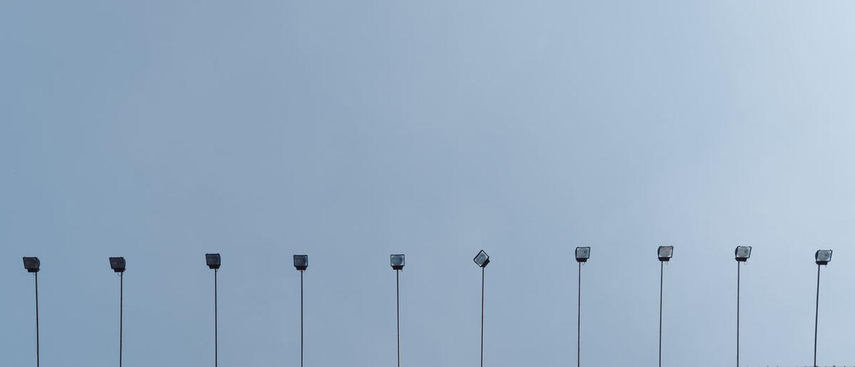 Low Angle View Of Floodlights Against Clear Sky