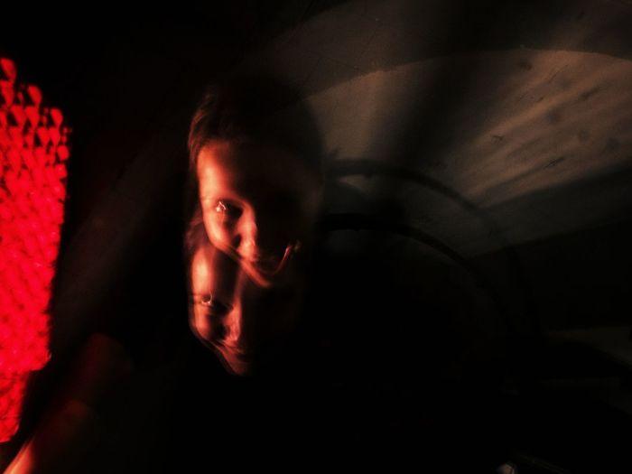 Portrait of man relaxing in darkroom