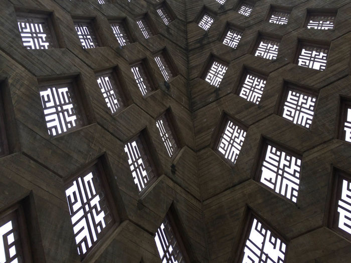Architecture Building Built Structure Ceiling Communication Day Indoors  Information Information Sign Lighting Equipment Low Angle View No People Non-western Script Pattern Script Text Western Script Window