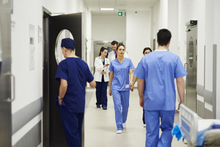 Busy surgeons during difficult operation Doctor  Walk Corridor Hospital Hurry Rush Urgency Emergency Clinic Specialist Group Of People Team Busy Work Surgery Surgeon Nurse Professional Occupation Medical Occupation Medical Uniform Uniform Apron Sterile Science Motion Meet Responsibility Medical Surgical People Indoors  Man Woman