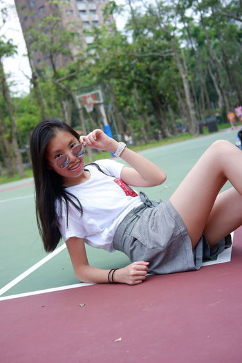 Portrait of young woman at basketball court