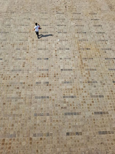 Playing solo Pattern Childhood One Child Child Running Tiled Floor Squares Mosaic Floor Boy One Boy Only One Boy Playing Playing Outdoors The Street Photographer - 2017 EyeEm Awards