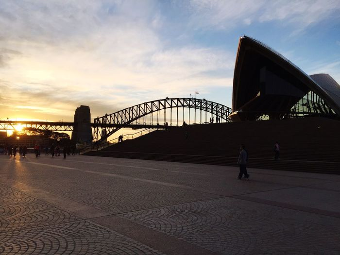 Backpacking Vacations Landscape Sydney Australia Operahouse Architecture Built Structure Connection Sunset Road Silhouette Sky Cloud Bridge Bridge - Man Made Structure The Way Forward Outdoors Long Sun Surface Level Tranquil Scene Footpath Cloud - Sky Outline City Life EyeEmNewHere