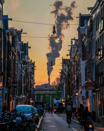 Under the smoke of Amsterdam Amsterdamcity Azizallach Industrial Smoke Streetphotography Streetlife Canonphotography Haarlemmerstraat Canon Roof Industrial Photography Magic Hour Dawn Daynight