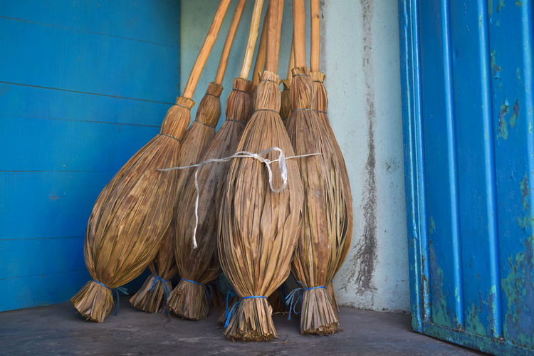 Brooms for sale on a porch in the Yucatan of Mexico Art And Craft Blue Broom, Wooden, Closeup, Swab, Manual, Floor, Dust, Parquet, Housework, Tidying, Dusty, People, Living, Household, Worker, Female, Tidy, Girl, Swabber, Woman, Housecleaning, Sweeping, Professional, Home, Servant, Work, Indoors, Janitor, Maid, Concept, Clea Building Exterior Day Equipment For Sale Group Of Objects No People Outdoors Portrait Side By Side Still Life Wood - Material