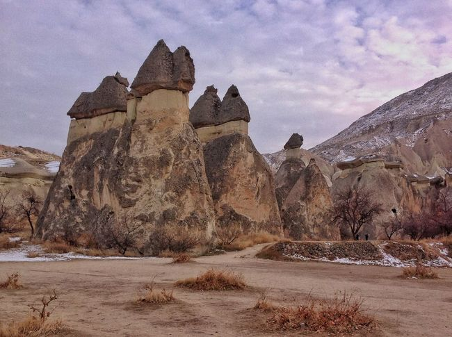 Fairy Chimneys😝 Rock Hoodoo Beauty In Nature Nature_collection Volcanic Rocks Göreme Open Air Museum Unessco World Heritage Site Mushroom Shape Rock Travel Destination Cappadocia/Turkey Senic View Panoramic View Volcanic Landscape Travel Destinations Lunar Landscape Nature Landmarks Nature Photography Snow ❄ No People Pyramid History Outdoors Architecture