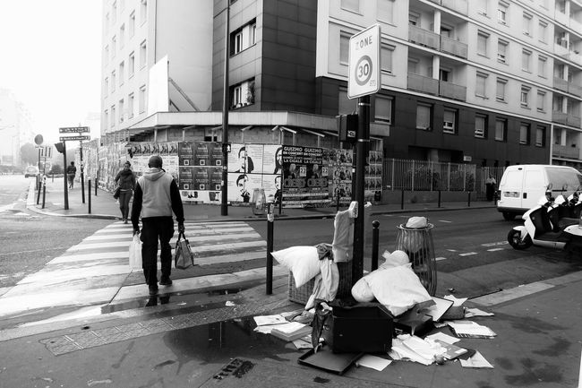 City Building Exterior Street Women Architecture Built Structure Men Adult Outdoors Embrace Urban Life full length Day Trash People Photography Life Photography Streetphotography Ghettoscenes Ghetto City Life Bnw Bw Bw_collection Canonphotography