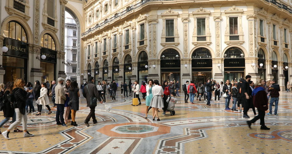 MILAN, ITALY- MARCH 7, 2017: Tourists walking and taking pictures with pigeons in Piazza Duomo of Milano fashion city. Ground view of this historic Gothic cathedral. tourists walking for shopping inside the Galleria Vittorio Emanuele II gallery in Piazza Duomo square. Famous fashion stores like Prada. Luxury and shopping concept. Cathedral Church City Duomo DuomoDiMilano Fashion Italia Milan Milan Italy Milan,Italy Milano Milano Italy Square Vittorio Emanuele II Vittorio Emanuele II Gallery Adult Arch Architectural Column Architecture Building Building Exterior Built Structure City Crowd Day Dome Duomo Di Milano Duomo Square Galley Group Of People History Italy Italy❤️ Large Group Of People Men Milanocity Outdoors Real People Statigram Tiled Floor Tourism Travel Travel Destinations Walking Women