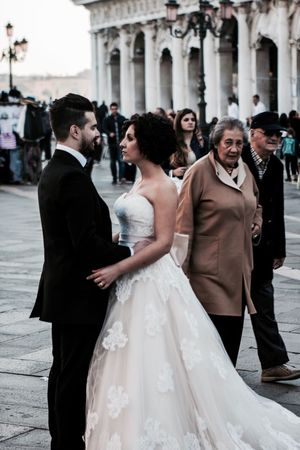 Bride Wedding Bridegroom Wedding Dress Adults Only Celebration Men Love Young Women Outdoors Place Of Worship Life Events Women Wife Well-dressed People Standing Togetherness Tuxedo Venice