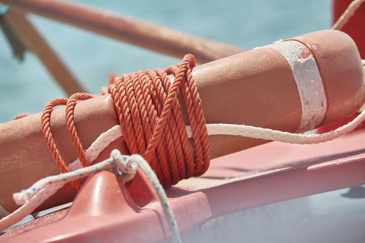 Close-up Connection Day Focus On Foreground Lifebelt Lifebelt Sea Mode Of Transportation Nature Nautical Vessel No People Outdoors Protection Rope Sea Security Strength Sunlight Tangled Tied Knot Tied Up Transportation Water