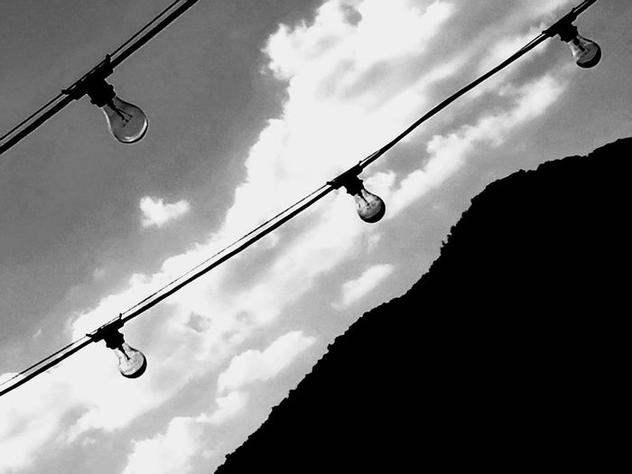 Black And White Low Angle View Cloud - Sky Sky Outdoors Silhouette No People Day Lightbulbs Lighting Equipment My Year My View Still Life Photography Fine Art Photograhy Pattern Texture Shape Design Lightbulb String Abstract Artistic Unusual Perspective Atmospheric Meditation