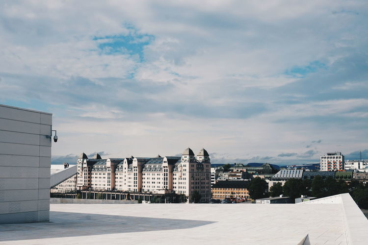 Oslo opera house against sky in city