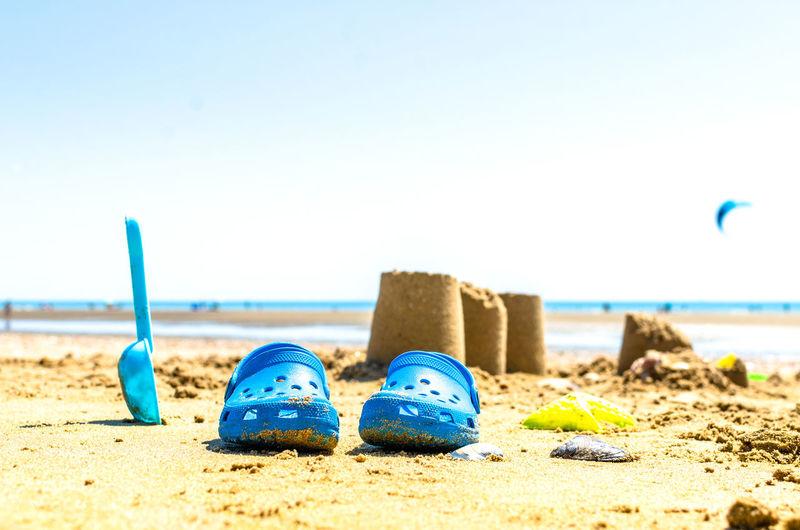 Surface level of beach against blue sky
