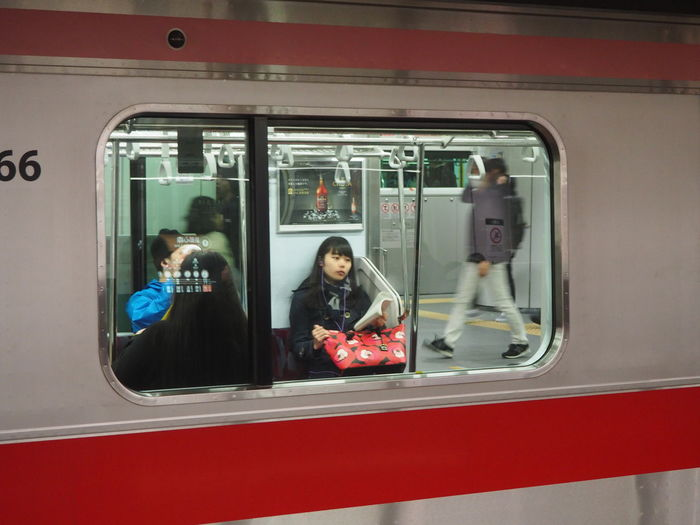 Commuter Train Day Journey Land Vehicle Lifestyles Metro Train Mode Of Transport Passenger Passenger Train Public Transportation Rail Transportation Real People Red Sitting Subway Train Technology Train - Vehicle Transportation Travel Two People Vehicle Interior Vehicle Seat Window Women The Street Photographer - 2017 EyeEm Awards The Portraitist - 2017 EyeEm Awards BYOPaper!