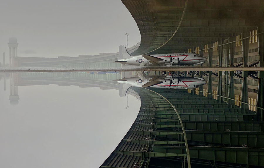 Puddleography Architecture Built Structure City No People Outdoors Reflection Reflection_collection Reflections In The Water Transportation Water
