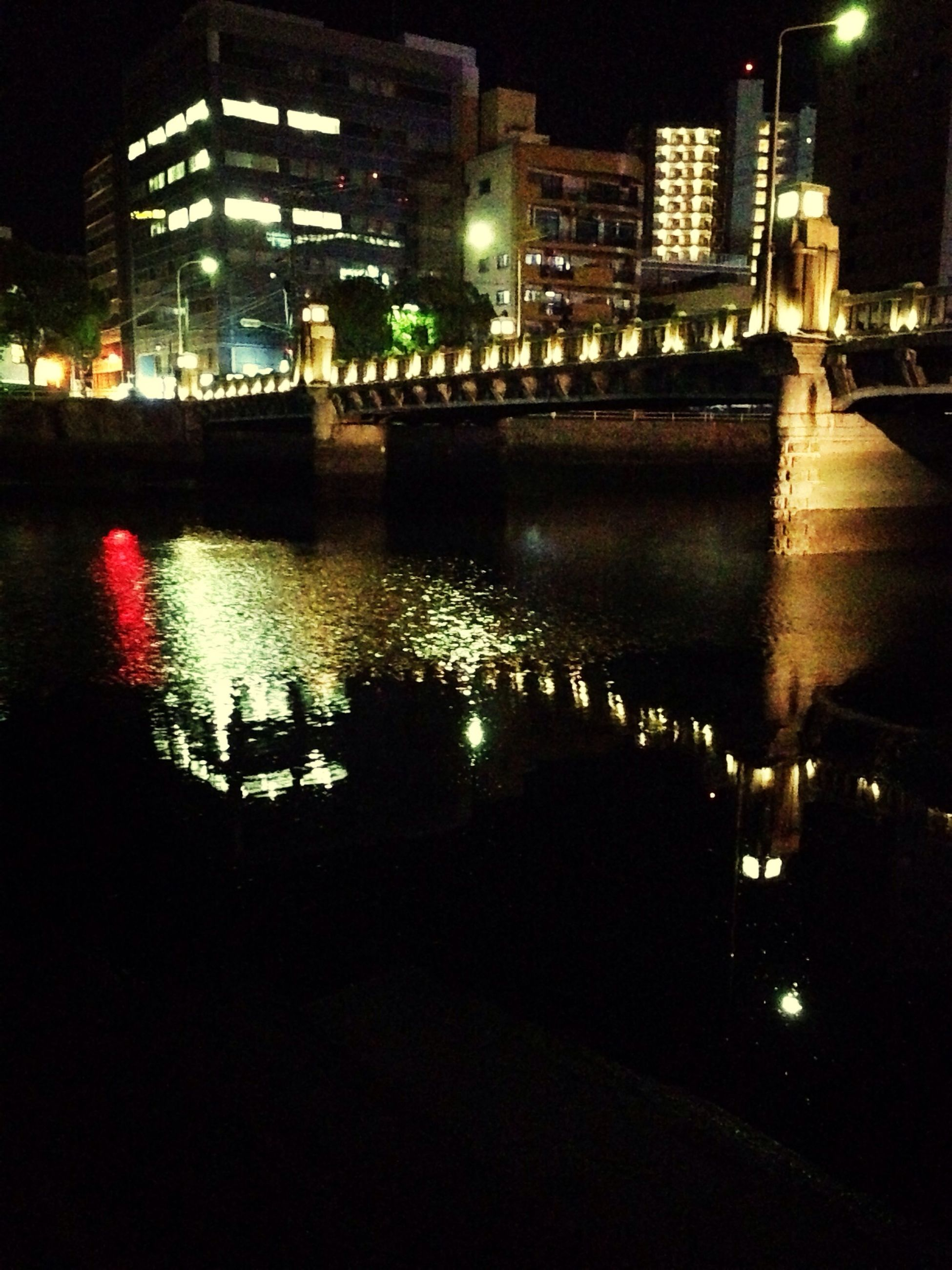 illuminated, night, building exterior, architecture, built structure, city, water, reflection, cityscape, river, street light, city life, waterfront, building, street, residential building, lighting equipment, skyscraper, modern, light - natural phenomenon