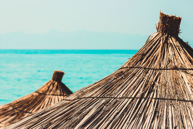 Thatched roof hut by sea