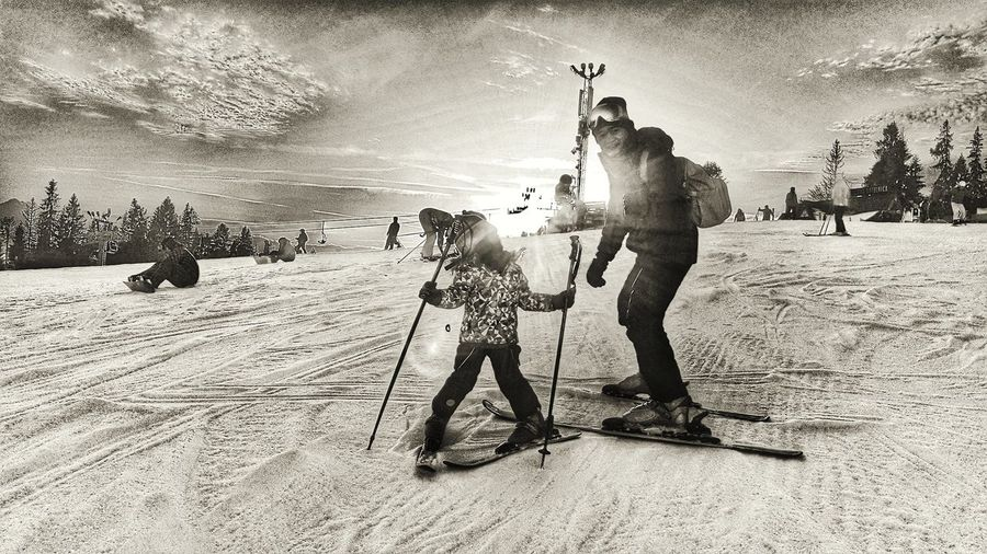 Learning to ski Family Skiing Holiday Father And Daughter Winter Sports Winter Silhouettes Silhouette_collection Silouette & Sky Ski Snow ❄ Black And White Black And White Photography Black And White Collection  Real People Only Men Men EyeEm Ready   EyeEm Ready   Shades Of Winter This Is Family