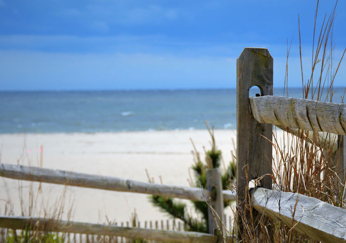 Beach Beauty In Nature Blue Close-up Day Focus On Foreground Horizon Over Water Nature No People Outdoors Railing Scenics Sea Sky Tranquil Scene Tranquility Water Wood - Material Wooden Post