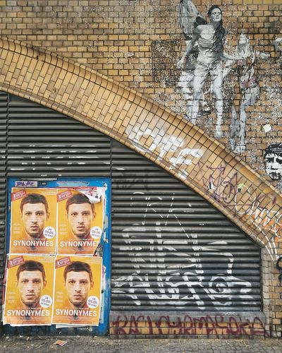 Portrait of people on wall