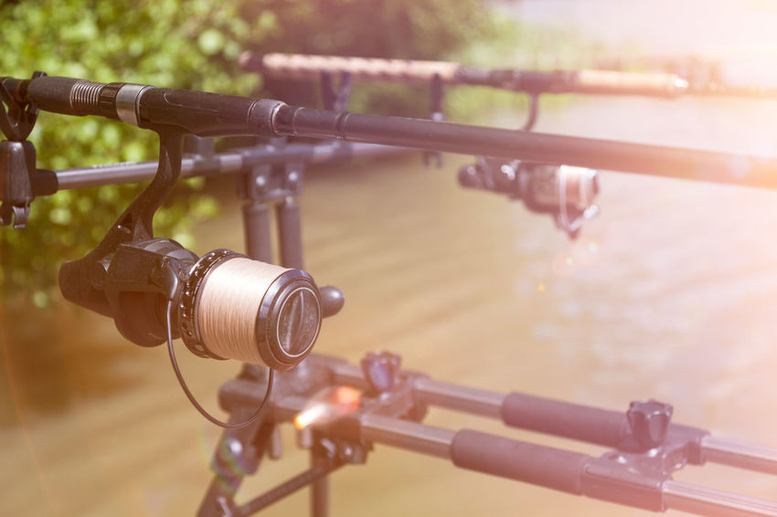 Rod pod with fishing rods. Angling Fishing Rod King Fisher RodPod Angling Rod Fish Fisherman Fishing Fishing Boat Nature Nobody Outdoor Outdoors Recreational Pursuit Rod Rod Pod Rods Sport Fishing Summer Sunflare