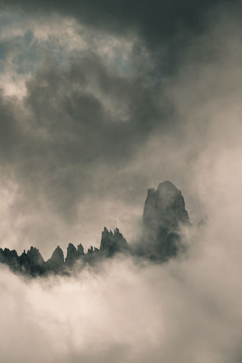 Rocky mountain peak and stormy clouds. tre cime di lavadero italy