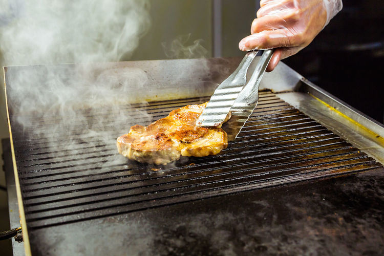 Man preparing food on barbecue grill