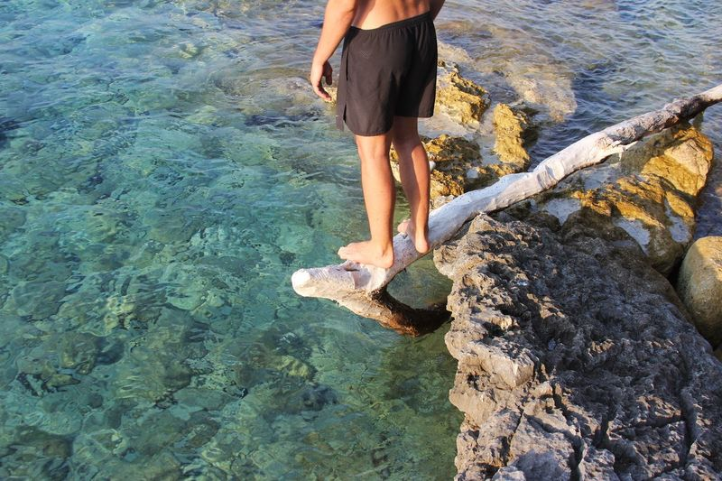 Cold Waters Water Low Section Real People Human Leg Human Body Part Lifestyles Body Part Leisure Activity Sunlight Sea Day Standing People High Angle View Nature Beach Rock Outdoors Urban Fashion Jungle Be Brave 50 Ways Of Seeing: Gratitude
