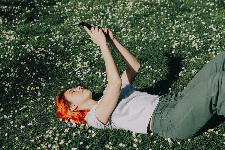 High angle view of woman lying down on land