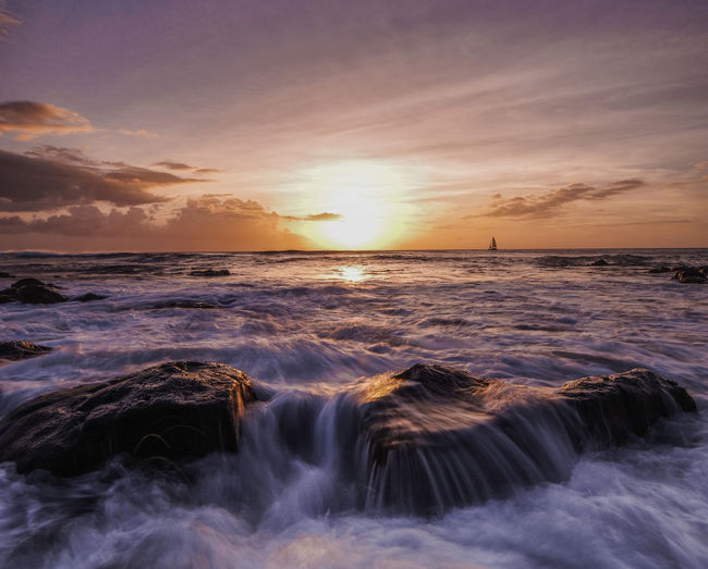 Photo taken at leftovers beach park, HI Hawaii Oahu Aquatic Sport Beauty In Nature Cloud - Sky Flowing Water Horizon Horizon Over Water Idyllic Land Motion Nature No People Outdoors Power In Nature Scenics - Nature Sea Sky Sport Sunset Tranquil Scene Tranquility Water Wave