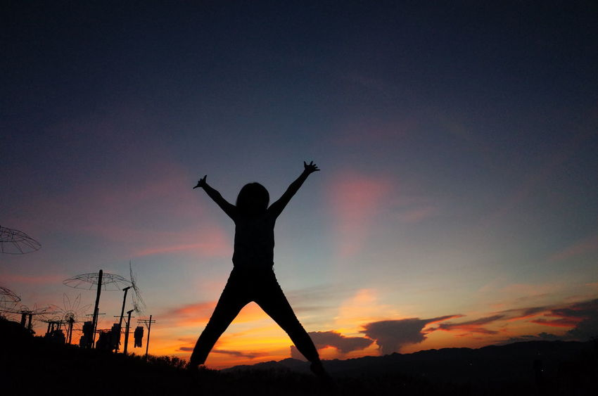 Silhouette Sunset Arms Raised Human Body Part Night People One Person Sky Outdoors Nature Full Length Adult Only Women Beauty In Nature One Woman Only Adults Only Human Hand