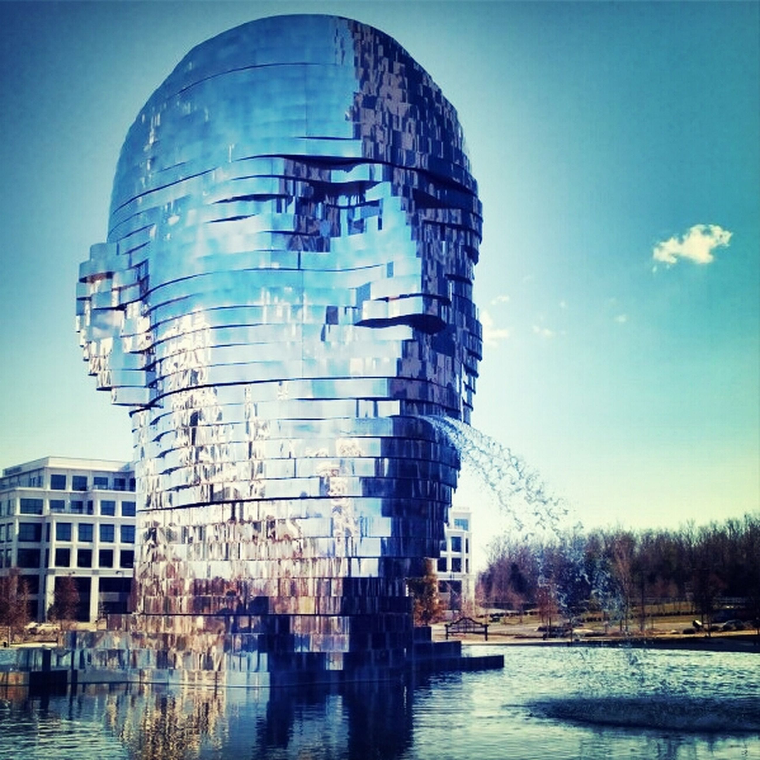 building exterior, architecture, built structure, water, reflection, waterfront, blue, sky, low angle view, city, building, river, day, outdoors, no people, clear sky, lake, sunlight, residential building, tower