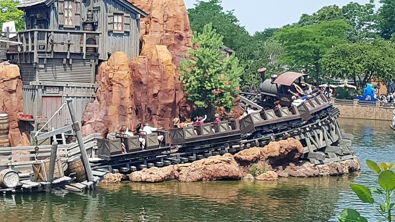 """Here is a Photo Shot of a Train travelling around Disneyland Resort Paris is version of """"Big Thunder Mountain"""". This Photo was taken in June 2017 within Frontierland - Disneyland Park - Disneyland Resort Paris. 2017 2017 Year Disneyland Paris Disneyland Paris 💚🎆🗼 Disneyland Resort Paris Disneyland Resort Paris 2017 Disneyland Resort Paris 25th Anniversary Hot Day Nice Day Paris Paris, France  Rollercoaster Architecture Building Exterior Built Structure Day Disneyland Paris 25 Disneylandparis Outdoors Runaway Train Trains Trains_worldwide Travel And Tourism Travel Destinations Water"""