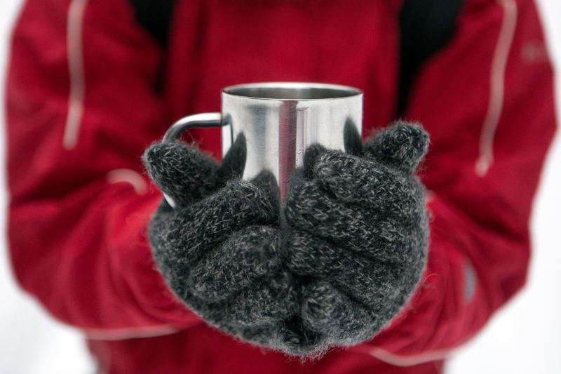 Close-up of hand holding tea cup