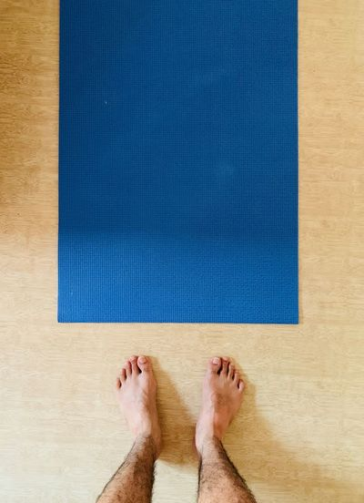 Yoga time Low Section Body Part Human Body Part Human Leg barefoot Personal Perspective Blue Human Foot Real People One Person Standing Adult Lifestyles Directly Above Leisure Activity Flooring High Angle View Indoors