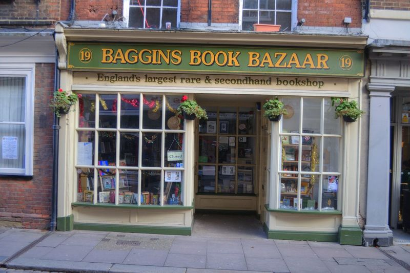 Baggins Book Bazar, book shop in Rochester, Kent, England. Baggins Books Bookstore Britain British Reading Rochester, Kent Used Bookstore Architecture Bookshop Building Exterior Built Structure City Communication England English Entrance Façade No People Retail Display Rochester High Street Sidewalk Sign Store