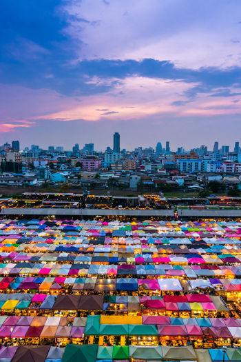 Illuminated Market In City At Dusk