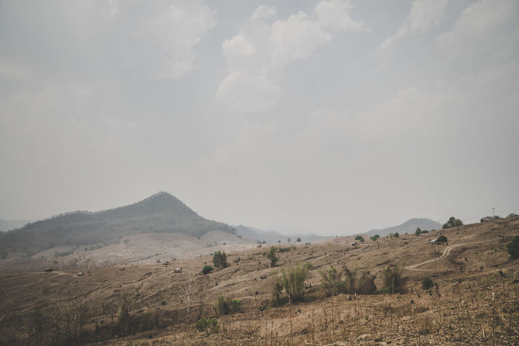Environment Mountain Landscape Tranquil Scene Scenics - Nature Beauty In Nature Tranquility Sky Nature Land No People Non-urban Scene Day Plant Outdoors Field Destroy Arid Landscape Arid Nature Photography Nature_collection Air Pollution Air Pollution City Fog