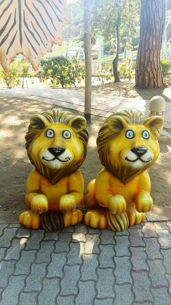 Day Animal Representation No People Statue Outdoors Sculpture Tree Nature Monkey Animal Themes Close-up EyeEmNewHere Sun Light Lion Lunapark Amusement Park Child Childhood Yellow Roaring Play Just For Fun Toys Baby