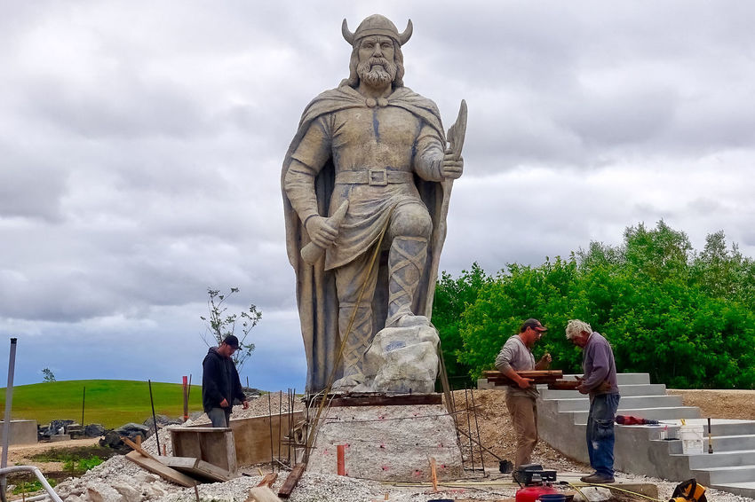 The landmark of the town Gimli in Canada is a viking statue. Grass Manitoba Trees Viking Statue Workers Canada Cloud - Sky Day Gimli Landmark Outdoors Real People Sculpture